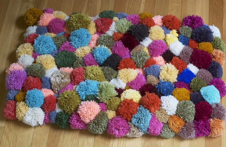 DIY Pom-Pom rug. Would be way cute in all one color