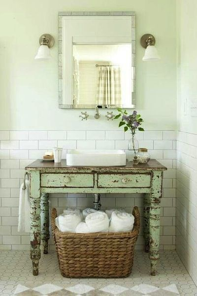2012 Idea House: Farmhouse Restoration: Vintage Bathroom: Give A New Room  Instant Age. A Perfectly Worn Painted Table Breaks Up The Sea Of White Tile  And ...
