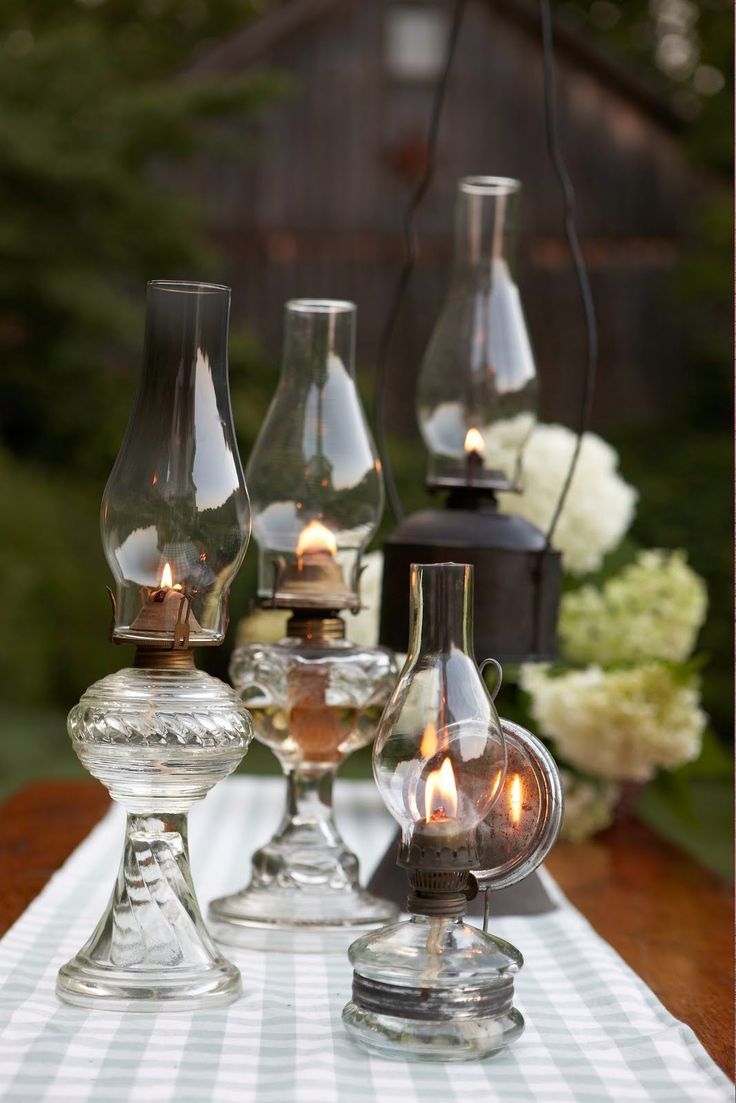 We have some stashed away in a closet, I really should get them out and use them for cocktails and dinner on the porch. Old Fashioned Oil Lamps.