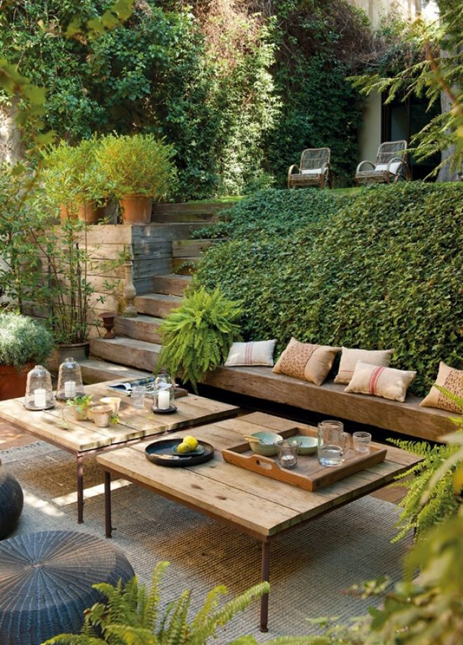I love the rustic wood bench nestled in the greenery, but from a practicality perspective, I can't help thinking SPIDERS in the ivy.