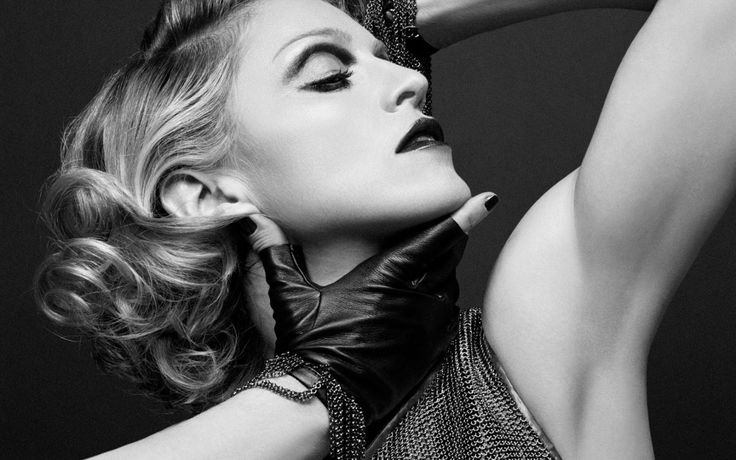 """Madonna has a new single and it's called """"Bitch I'm Madonna"""". First of all, I don't understand why the video has so many dislikes. People are complaining that Madonna is not acting her age. Hmm… something tells me that a lot of these """"haters"""" are underage and don't know who she really is. Once upon a time, before all these so-called """"bad bitches"""" in the game, there was Madonna, the baddest bitch of them all."""