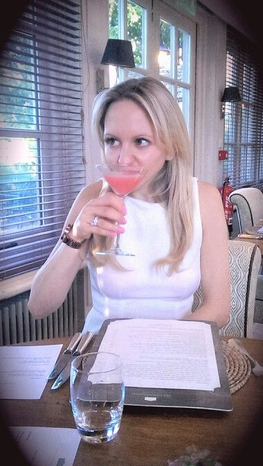 Daughter Kim tasting a cocktail.