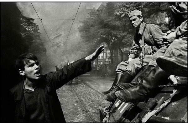 Prague Invasion, 1968 - Josef Koudelka / Dozens of people were killed in a massive military clampdown in Czechoslovakia by five Warsaw Pact countries. Koudelka's black and white pictures of the demonstrations and confrontations were widely published at the time.