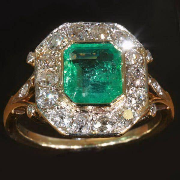Estate diamond and Columbian emerald engagement ring