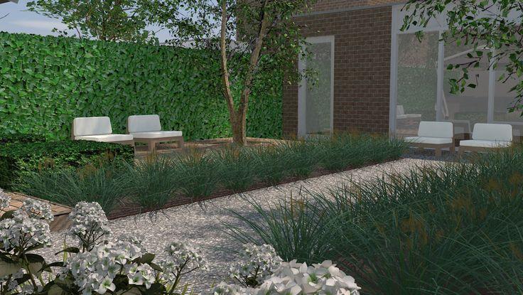 Kleine achtertuin. Diverse zitplaatsen, maar toch een heel groene uitstraling.
