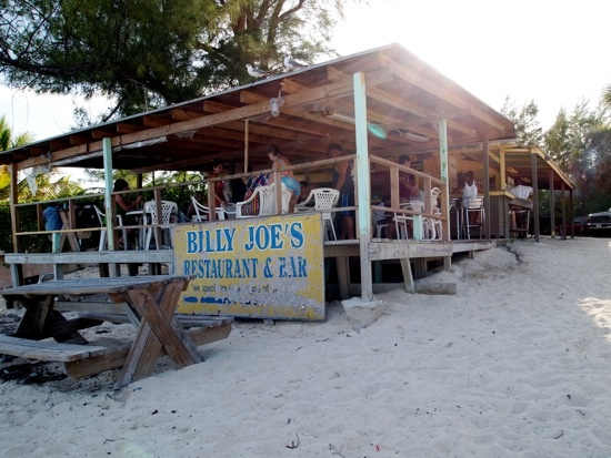 """Billy Joe's, Grand Bahama Island, Bahamas.  """"Celebrities, Our Lucaya guests and locals are all drawn to Billy Joe's for its strong drinks, cold beer and laid back beachfront atmosphere, but undoubtedly the main attraction is the cracked conch."""""""