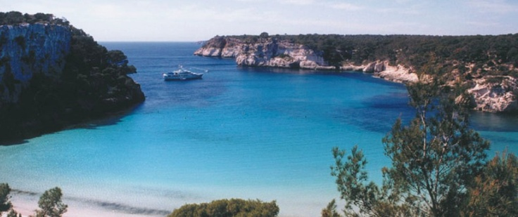 Cala Anguila beach. Crystall blue water and white sand. Has a diving area and a yatch club
