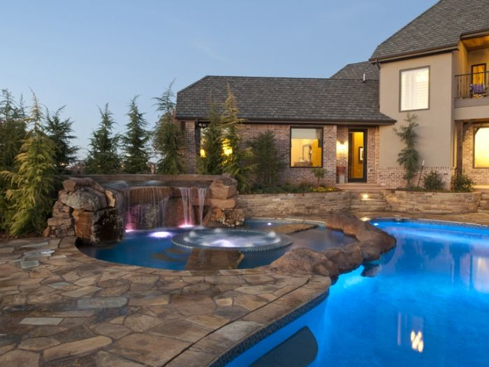 ingenious landscape lighting around pool. Unexpected Spa and Pool Combo by Caviness Landscape Design 91 best images on Pinterest  House porch Arbors