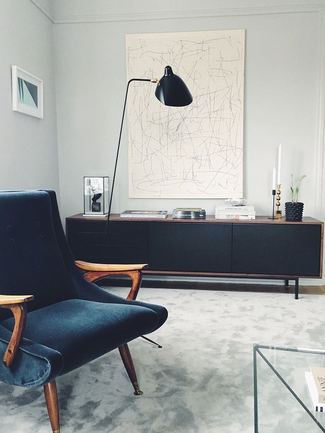 Mid-century style living room, so elegant and cool. Modern and fresh outfit, with white boyfriend jeans, diagonal long white shirt with black trim, and black ankle-strap heels. Classic cocktail … one