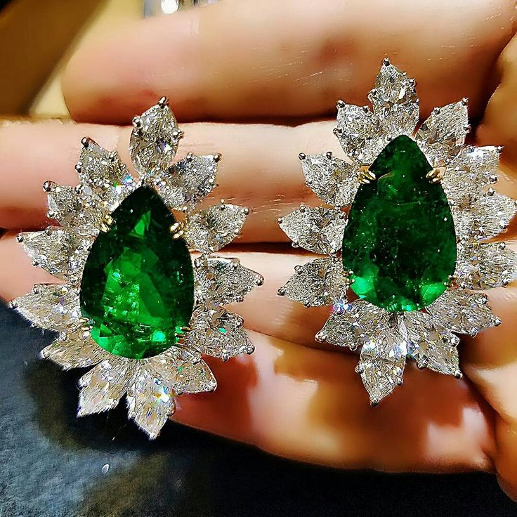 A fine example of the most desirable #EMERALDS on the color spectrum is #SharpJewelsNY exquisite pair of #Pearshape emeralds, origin: Colombia, accompanied with Gübelin geological reports, 20.73 carats, minor oil, decorated with #GIAcertified #FancyCut colorless diamond surround: 24.80 carats mounted in platinum and 18K yellow gold