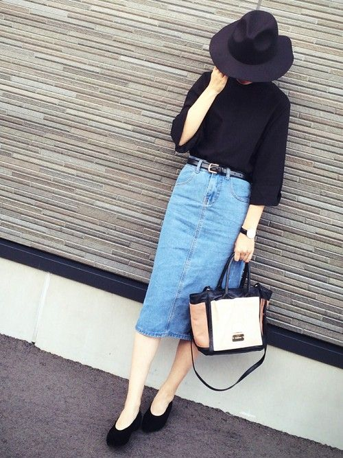 Black sweater and denim skirt