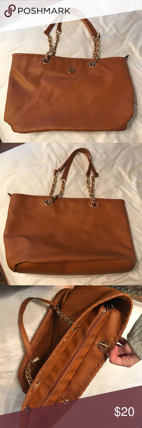 Tan Purse Fashionable and professional tan purse, zipper to close, striped interior with pockets and zipper pocket inside. Sometimes the arm straps come out of the little hole clasps, but other than that it's a great Purse! I'm unsure of the brand, no tags on it. Bags Totes