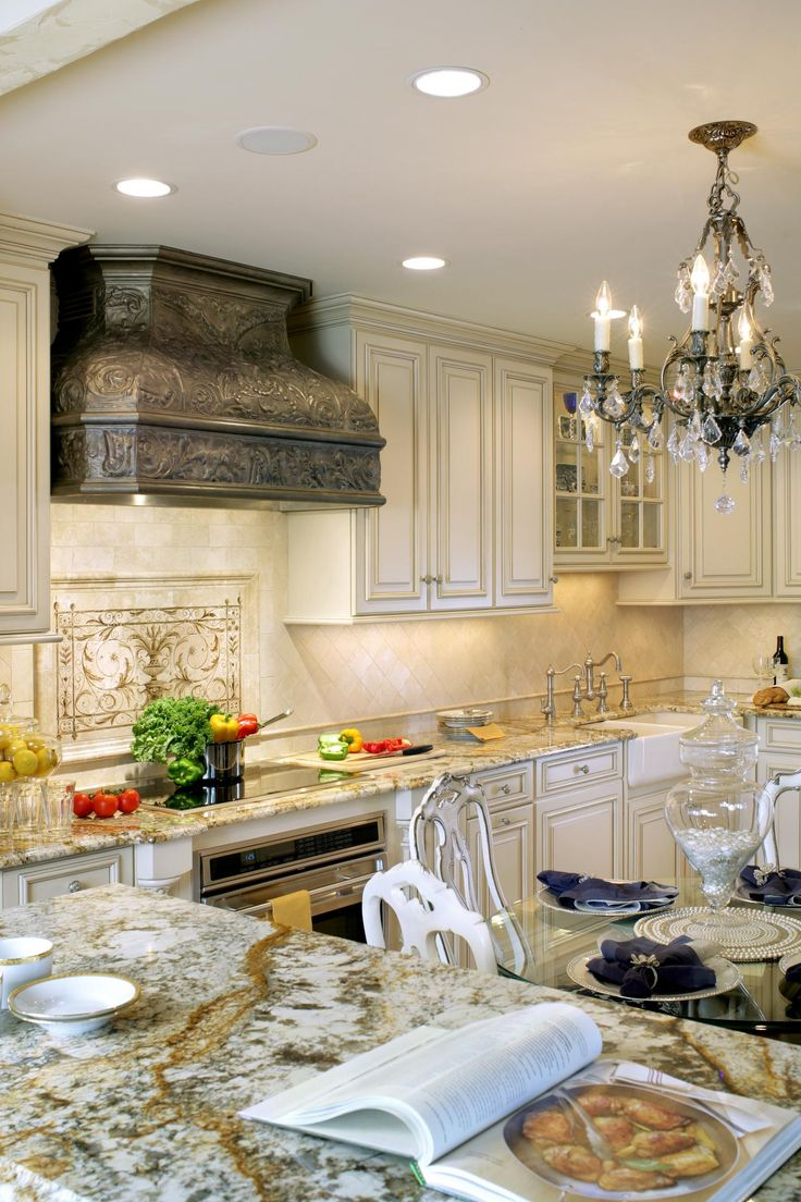 This neutral traditional kitchen features a custom