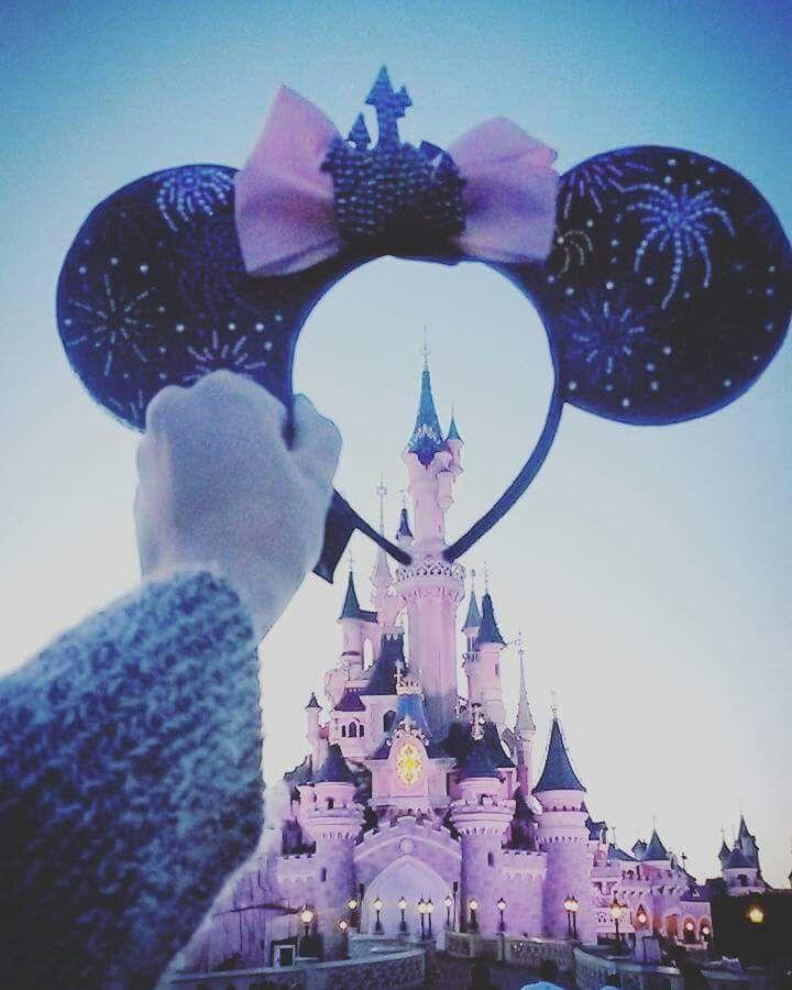 Minnie Mouse ears and the Sleeping Beauty Castle in Disneyland Paris DLP 'Le Château de la Belle au Bois Dormant'