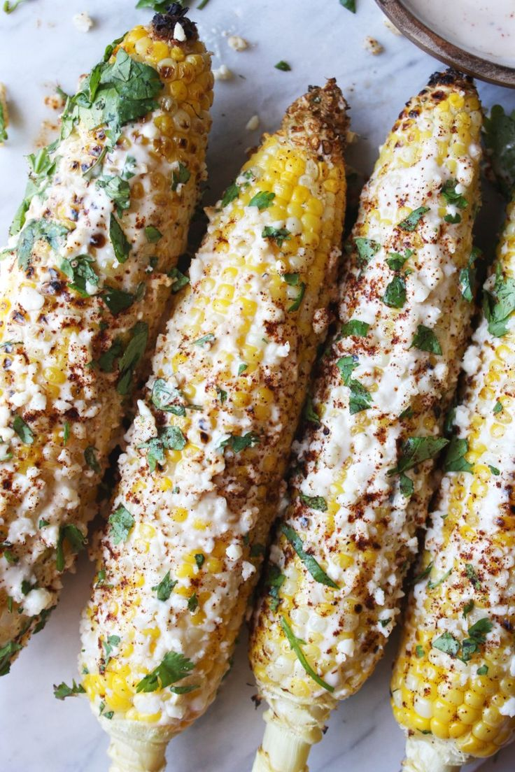 Hello, gorgeous. Have you guys ever had Mexican street corn before? No? Get in your car and drive to the grocery store. Pronto. Get some corn. Make this…now! This is one of those things that …