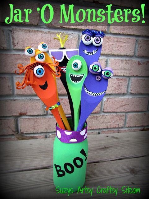 Jar O' Monsters Halloween Decor made with wooden spoons.