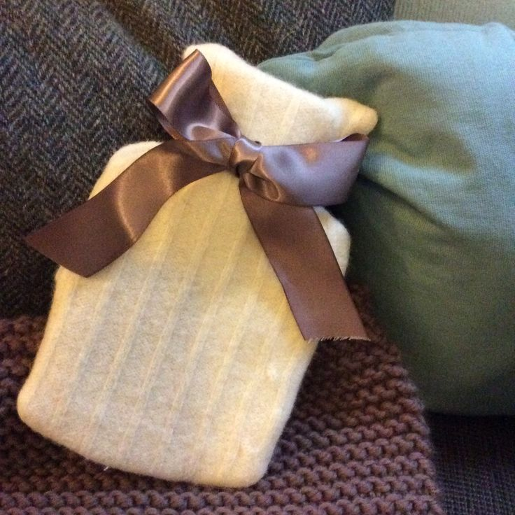 Keep warm with hot water bottle covers recycled from shrunken jumpers.