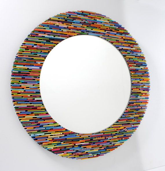 brightly colored round  mirror, wall art- made from recycled magazines. $150.00, via Etsy.