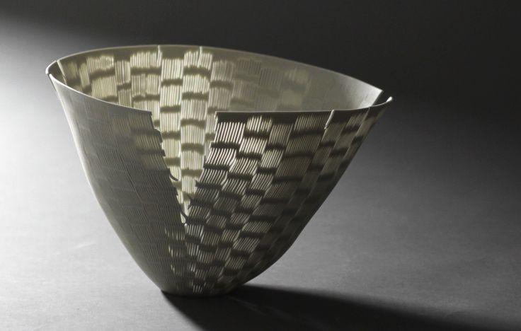 Handperforated poreclainbowl by Linda Prüfer