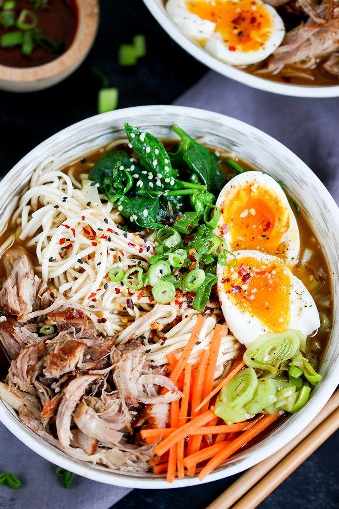Spicy Pork Ramen - Slow cooked pork with noodles, veggies and a just-slightly-runny egg. Full of that delicious umami flavour!