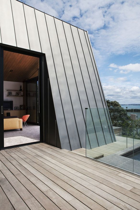 House with vertical zinc cladding