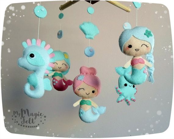 Baby mobile mermaids Crib mobile Mermaids nursery mobile Under sea baby girl mobile Mermaid baby mobile Sea horse baby Shower gift ✂ MAKING TIME is 6 weeks ✈ Delivery time is 2-4 weeks depending on your location ★.•* • . You want to make it in Personal Colors? Just write me . • *•.★ You can see My Felt Palette in the last photo Includes: - Mermaid - 3 pcs - sea Horse, height about 4.5 inch / 11.5 cm - octopus, height about 3.5 inch / 9 cm - little shell • • • • ● ● ● A...