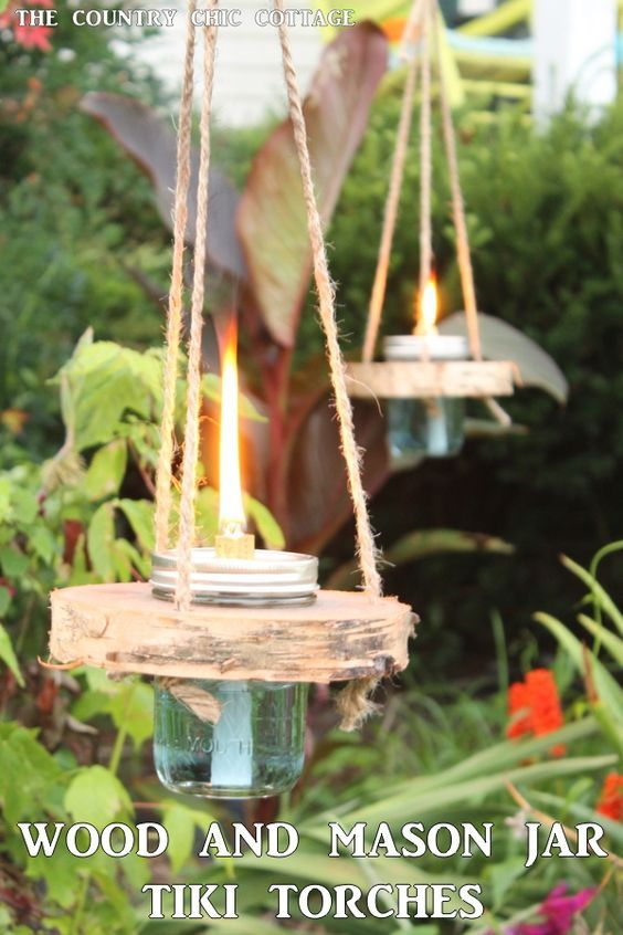 Wood and mason jar tiki torches -- tackle this outdoor project for a fun addition to any outdoor area!  Get the step by step instructions here!