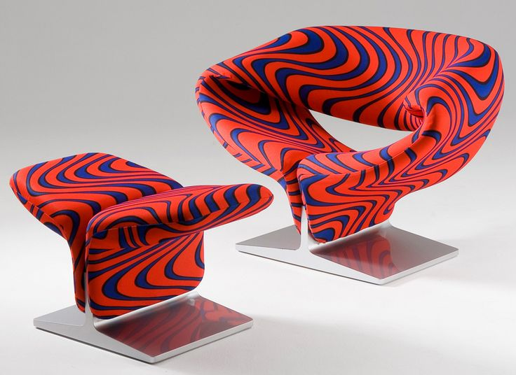Paulin's ribbon chair, originally designed in 1966, remains popular today. This groovy incarnation of the ribbon chair is featured for sale on hivemodern.com. // Made by Artifort, Holland //  Designed by Pierre Paulin