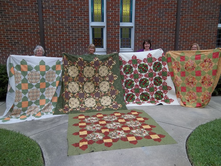 Five beautiful variations on the same pattern.  I'm holding the one on the far right.