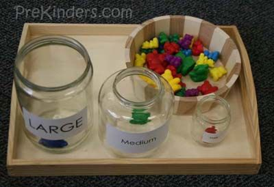 Sorting the bears into the jars labeled small, medium, and large, depending on the size of the bear. http://www.prekinders.com/math-sorting/