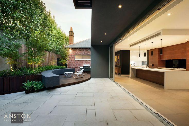 Nathan Burkett Design's stunning patio design features the Granite Range Vega paver in an Ashlar pattern.
