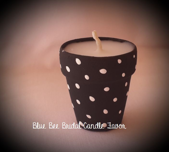 Polka dot clay pot filled candle favors