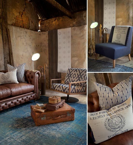 mixing leather with blue reupholster existing leather armchair in plain blue linen place in front fire place with round oak table