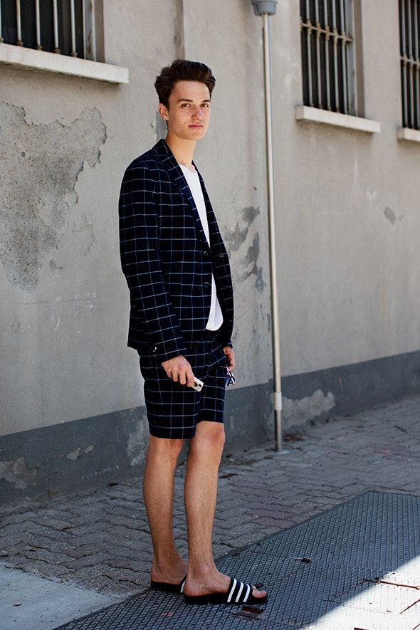 Shot by Scott Schuman - This guy knows how to wear a window pane check suit. Not too sure about the adidas 3 stripe slides but I guess it works really well for an off-duty look on a hot summers day in Milan.