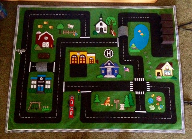 Car felt play mat.  Designed for my grandchildren.  2015