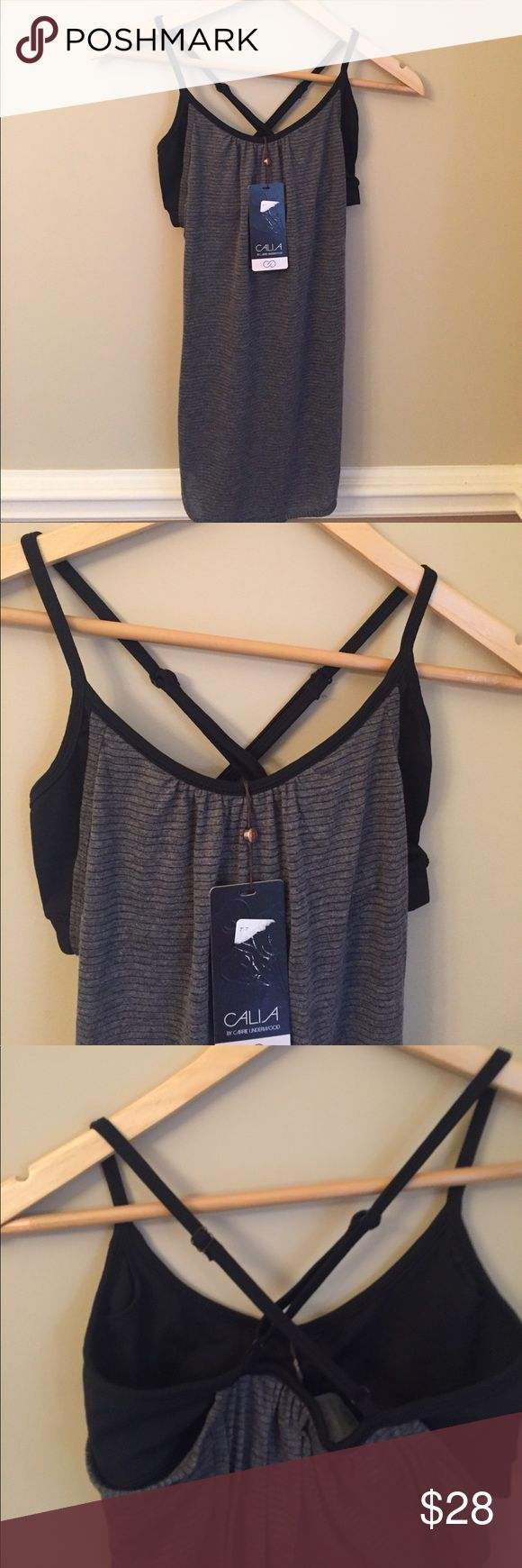 🌸NWT CALIA by Carie Underwood Bra Shelf Tank🌸 Brand New with Tags CALIE by Carie Underwood grey with black stripes tank top. Loose fitting with black bra shelf. Size XS. Very soft material. Smoke free home CALIA by Carrie Underwood Tops Tank Tops