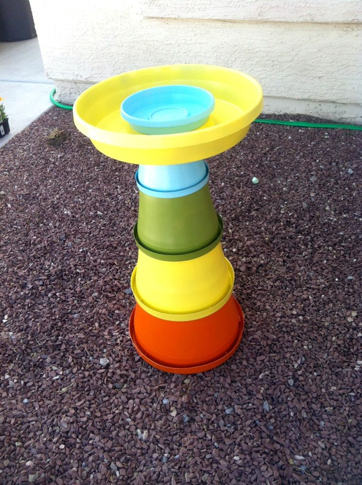 My Homemade Bird Bath & Bird Feeder for my garden. -Using plastic panter pots and saucers from Home Depot, Spray Paint, and Hot Glue =Total Cost 17.07