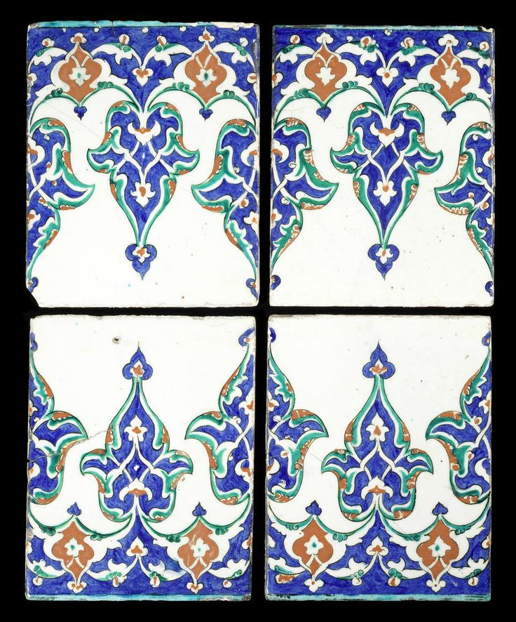 Iznik pottery Tiles  Turkey, 1575-85 each rectangular, decorated in cobalt-blue, green, raised red and black on a white ground with a frieze of arabesque-filled, large trefoils