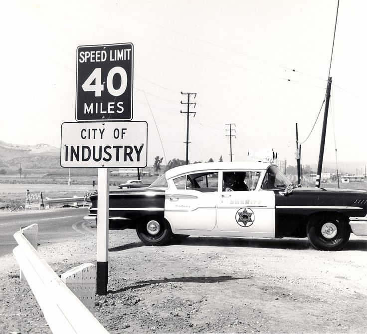 The City of Industry in Los Angeles County, with a 1958 Chevrolet L.A. Sheriff's Department car (ca. 1958)