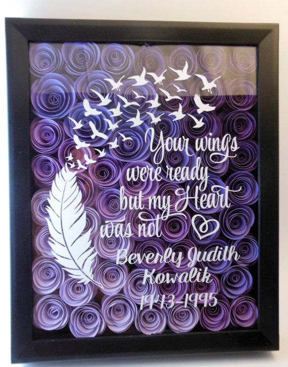 Each shadow box is 8x 10 and filled with rosebuds that are rolled by hand. These roses are made with quality card stock. The saying on the shadow box reads: Your wings were ready but my heart was not The color of the roses can be chosen in the drop down menu. If you would like the roses a color that is not listed send me a message and Ill be more than happy to try to accommodate your request. The wording on the shadow box is cut from quality permanent vinyl and can be requested in any…