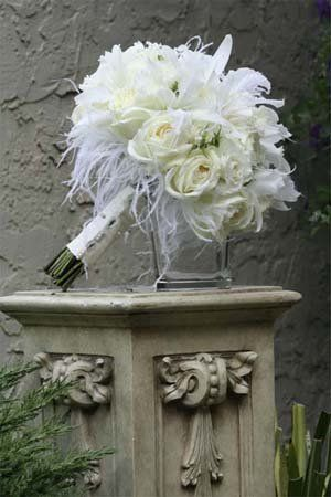 How to Make a DIY Feather Pomander - Project Wedding.  Feathers and flower for room
