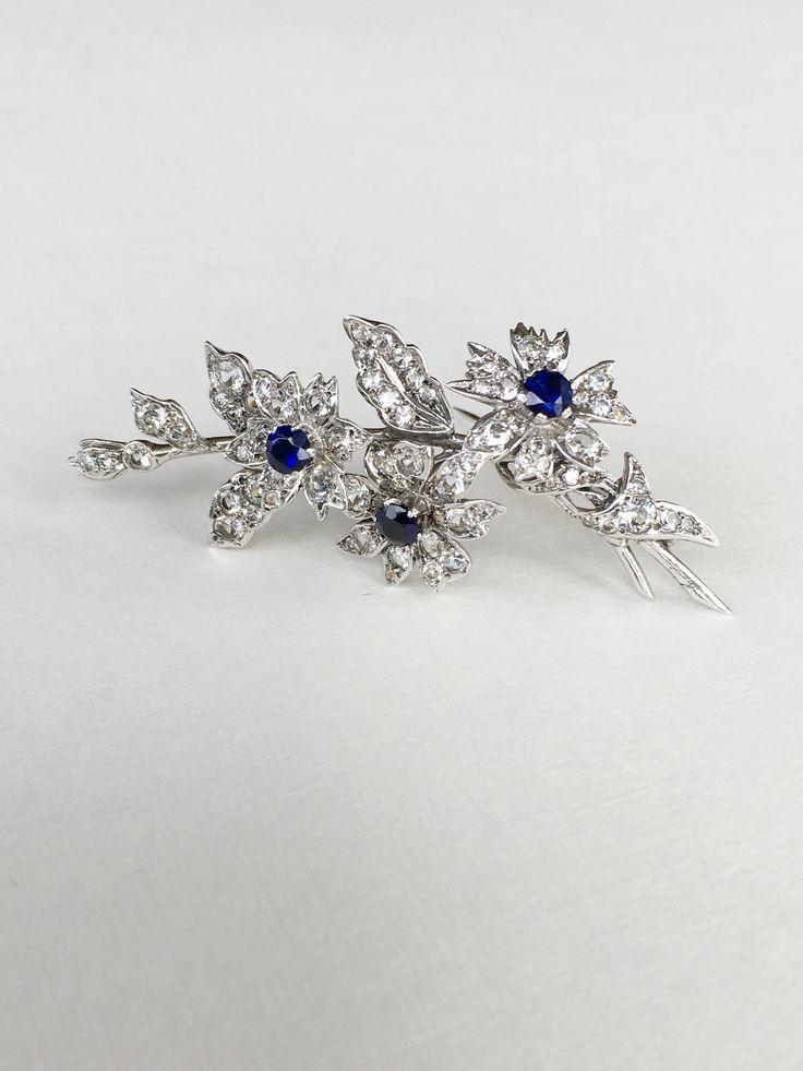 Vintage  silver blue  glass clear rhinestones  Floral brooch by MariniJewellery on Etsy https://www.etsy.com/ie/listing/562447161/vintage-silver-blue-glass-clear