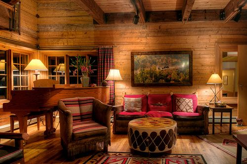 Simple western rustic cabin decor! Love the drum coffee table