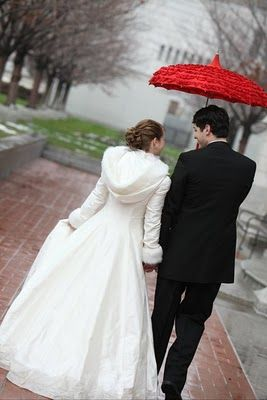 I am adoring her coat!  WOW! Perfect for a winter wedding! My sister needs one of these stunning