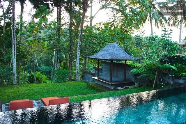 View of the infinity pool, jungle ravine, gazebo and rice fields from the master suite and living room windows!