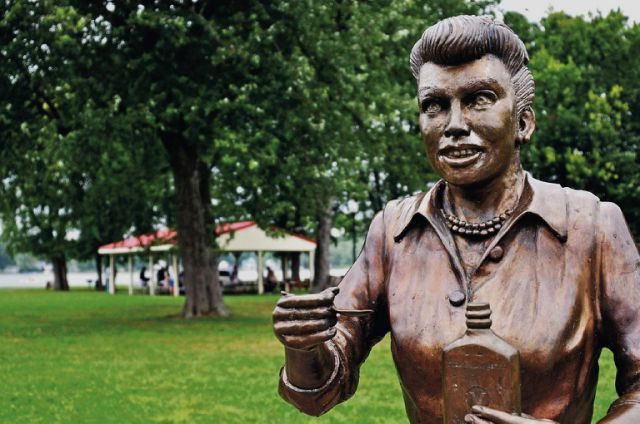 """In this Aug. 2012 photo, a bronze sculpture of Lucille Ball is displayed in Lucille Ball Memorial Park in the village of Celoron, N.Y. The statue that drew worldwide scorn earlier this year for its unflattering depiction of the """"I Love Lucy"""" star has provided inspiration for an annual haunted house event in a mall near her western New York town. Event planner Scott Mekus says an actor portraying the Scary Lucy statue will part of the Chautauqua Mall's """"Haunting at the Mall"""""""