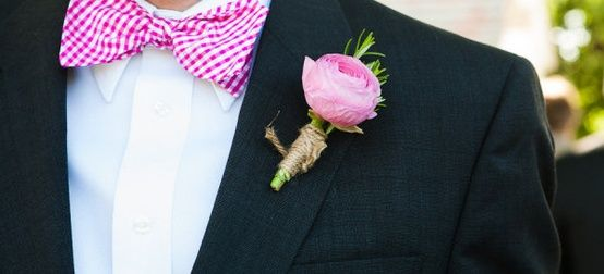 A pop of pink: for the groomsmen, go for dashing gingham bow ties and matching boutonnieres.