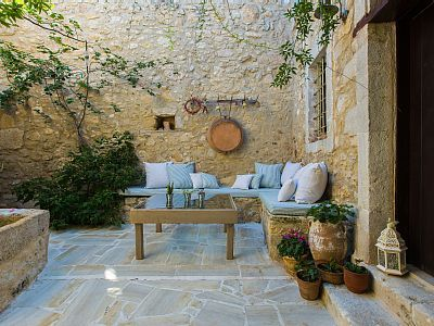 Rethymno villa rental - Stone paved courtyard with sitting area!