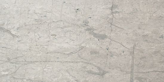 Colour: Beau Pearl Finish: Honed Grey marble with some fossil deposits and some black veining.