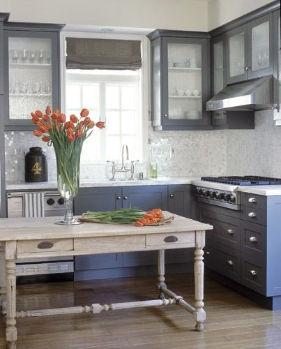 LOVE the grey/slate blue cabinetry and the reclaimed wood table (vs. an island) in this kitchen!!